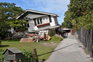 A two story house collapses during a 6.2 magnitude earthquake