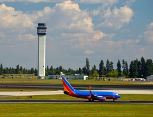 © Frankljunior | Dreamstime.com - Air Traffic Control Tower And An Airplane Photo