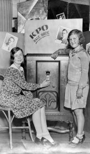 Bernice Baumgartner and Edith Nare listen to radio KPO in 1930. KPO was one of four new stations in S.F. in 1922. KPO was owned by Hale Bros. department store and broadcast at the Fairmont Hotel.